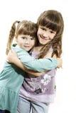 Hug de duas irmãs Fotos de Stock Royalty Free