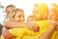 Hug in group as teambuilding event. Embrace in group as teambuilding event in nature stock photos