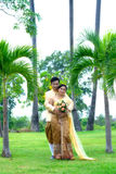 Hug marry couples Stock Images