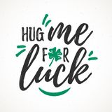 Hug Me For Luck. Handdrawn dry brush style lettering, 17 March St. Patrick`s Day celebration. Suitable for t-shirt, poster, etc stock illustration
