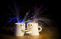 Hug me. Mugs, explosion of stars. Emotions and expressions. Relationships, love. Blue, light blue, purple, sparkling. You and me together. Smile, happiness stock images