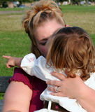 Hug From Mom 2. Mother holding her young daughter, who is pointing over her mother's shoulder royalty free stock photos