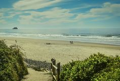 Hug Point, Cannon Beach, Oregon,USA. Pacific Coastline. Hug Point State Park Beach. Cannon Beach, Oregon, USA. Picturesque uncrowded beach with several sandstone Royalty Free Stock Photo