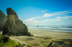 Hug Point, Cannon Beach, Oregon,USA. Pacific Coastline. Hug Point State Park Beach. Cannon Beach, Oregon, USA. Picturesque uncrowded beach with several sandstone Stock Photos