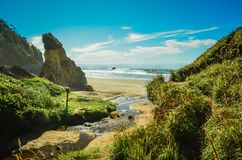Hug Point, Cannon Beach, Oregon,USA. Pacific Coastline. Hug Point State Park Beach. Cannon Beach, Oregon, USA. Picturesque uncrowded beach with several sandstone Stock Photography