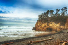 Hug Point on Oregon Coast. Stormy weather threatens the abandoned beach at Hug Point, Oregon.  The majestic landscape of sculptured shoreline topped with wind Stock Images