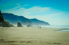 Hug Point, Cannon Beach, Oregon,USA. Pacific Coastline. Hug Point State Park Beach. Cannon Beach, Oregon, USA. Picturesque uncrowded beach with several sandstone Royalty Free Stock Image