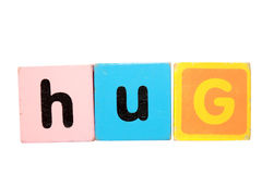 Hug in toy play block letters on white Stock Photography