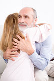 Hug between two elderly persons Royalty Free Stock Images