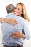 Hug between two partners Stock Photography