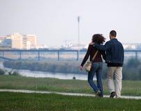 The Hug Walk At Promenade. Young couple walking down the Sava river promenade stock photos