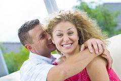 Hug and whisper Royalty Free Stock Photos