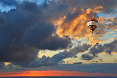 Huge air balloon flying over the sea Stock Image