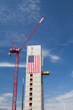 Huge American flag adorns buildings under construction along Har Stock Image