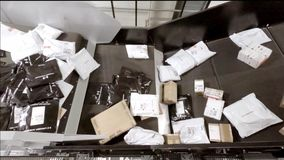 Huge amount of parcels bein transported on conveyor belts - time lapse 96 times faster