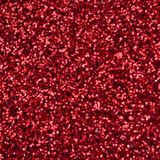 A huge amount of red decorative sequins. Blurred background image with shiny bokeh lights from small elements that reflect light i stock photography