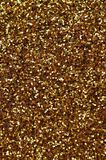 A huge amount of yellow decorative sequins. Background texture with shiny, small elements that reflect light in a random order. Gl. Itter texture Stock Photography