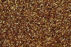 A huge amount of yellow decorative sequins. Background texture with shiny, small elements that reflect light in a random order. Gl. Itter texture Stock Image