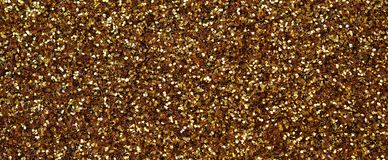 A huge amount of yellow decorative sequins. Background texture with shiny, small elements that reflect light in a random order. Gl stock photos