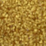 A huge amount of yellow decorative sequins. Blurred background image with shiny bokeh lights from small elements that reflect ligh stock photo