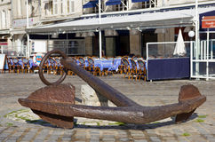 Huge ancient anchor - La Rochelle. Very big ancient anchor placed on a square of the La Rochelle harbour (in France) near the Tour de la Chaine Stock Photography