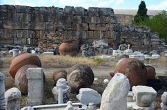 Huge antique clay amphoras against the backdrop of the ruins of the ancient city of Hierapolis near Pamukkale royalty free stock photos
