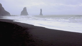 Huge arched black sand beach in Iceland stock video footage