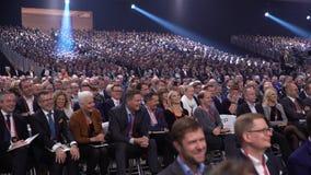 Huge audience listens to the speaker.
