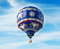 The huge balloon flies in the blue sky Stock Photography