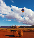 Huge balloon flies Stock Photography