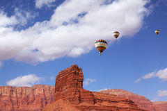 Huge balloons  flying over cliffs Royalty Free Stock Photos
