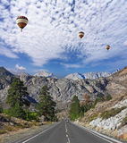 Huge balloons over the  road Stock Photos