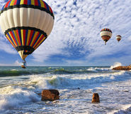 Huge balloons, sea, a spring storm Royalty Free Stock Photo