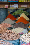 Huge barrels of colorful herbs and spices stacked in little shop in souks of Fez, Morocco Stock Images