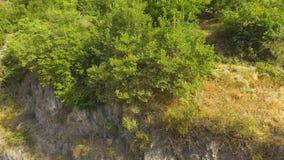 Huge basalt rock with little village on top, Armenian landscape, recreation. Stock footage stock video