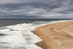 Praia Do Norte Portugal. A huge beach called Praia Do Norte, in Portugal, seen from a cliff Royalty Free Stock Photography