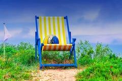 Gigantischer Deckchair. Huge beach chair with colorful ball Stock Image