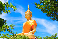 Huge Beautiful Golden Buddha Statue with Blue sky. In Thailand Stock Photos
