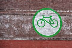 Big bicycle sign on the brick wall stock images