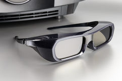Huge black home cinema projector with 3D glasses Stock Image
