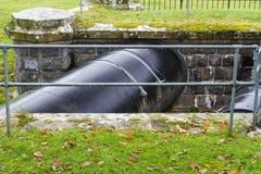Huge Black Pipe transporting water United Kingdom. Royalty Free Stock Photo