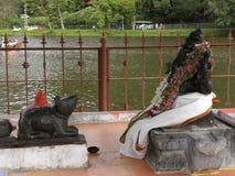 Kodaikanal, Tamil Nadu, India - June 11, 2010 Huge black stone statue of sitting Lord Ganesha at Kodaikanal Lake stock photo