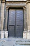 Huge black wooden doors of church in Barcelona Stock Images