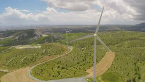 Huge blades rotating in wind for alternative power generation, renewable energy. Stock footage stock video footage