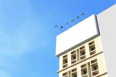 Huge blank billboard on the building Stock Images