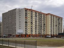 Huge block of flats building. For big population in city. People living more economic stock photo