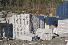 Huge blocks of stone in a stone quarry. The quarry is located on Ystehede in Halden municipality. Norway. In the quarry the stones are broken for building and Royalty Free Stock Photos