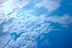 A huge blue sky with tiny clouds. use as background or wallpaper. A huge blue sky with tiny clouds royalty free stock photo