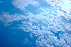 A huge blue sky with tiny clouds. use as background or wallpaper. A huge blue sky with tiny clouds stock photo