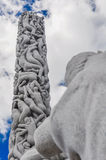 Huge bodies column sculpture in Frogner Park, Oslo. Aged sculptures against a bright cloudy sky in Oslo, Norway stock image